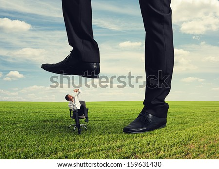 boss trampling down bad worker in the land - stock photo