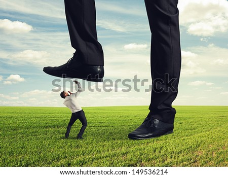 boss trampling down in the land his subordinate - stock photo