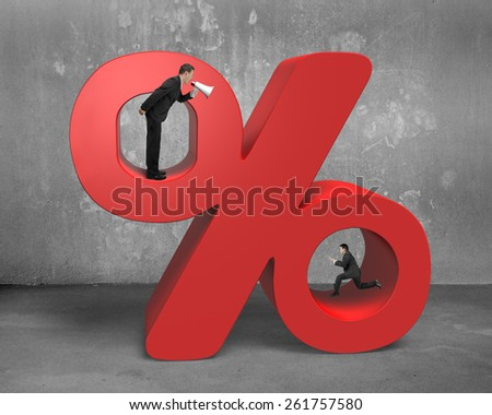 Boss using megaphone yelling at running employee holding tablet with red percentage sign on concrete wall and floor background - stock photo