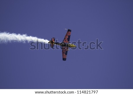 BOSSIER CITY, LA - APRIL 21: The stunt plane performs high speed turns and fly-by maneuvers at the Barksdale AFB airshow on Apr 21, 2012 in Bossier City, LA.