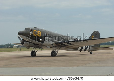 """BOSSIER CITY, LA - MAY 8: A World War II C-47 """"Dakota"""" taxis out for a performance at the Barksdale AFB airshow on May 8, 2011 in Bossier City, LA. - stock photo"""