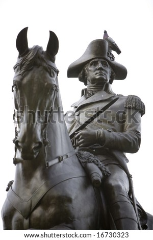 BOSTON 2008:  An equastrian statue of General George Washington on public display at the Boston Public Garden, a public park.  A pidgeon stands on the sculpture's hat. - stock photo