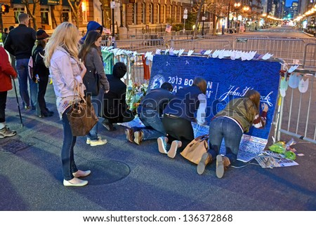BOSTON-APR 18:People poured over the memorial set up on Boylston Street in Boston,USA on April 18,2013. More 23300 runners take part in Marathon. 3 people killed,over 100s injured on April 15,2013. - stock photo