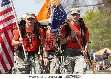 BOSTON - APRIL 16 : Fans cheer on Syracuse ROTC marching the boston marathon in full 40 lb ruck-sacks during the Boston Marathon April 16, 2012 in Boston. - stock photo