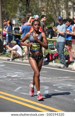 BOSTON - APRIL 16: Genet Getaneh (ethiopia) races up Heartbreak Hill during the Boston Marathon on April 16, 2012 in Boston. Sharon Cherop (Kenya) finished first with a time of 2:30:50. - stock photo
