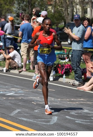 BOSTON - APRIL 16 : Jeptoo (Kenya) races up Heartbreak Hill during the Boston Marathon on a hot 87 degree day on April 16, 2012 in Boston. Sharon Cherop (Kenya) finished first with a time of 2:30:50.