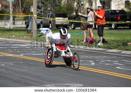 BOSTON - APRIL 16: Joshua  Cassidy raced the Boston Marathon.  He won the race in record time of 1:18:25 on April 16, 2012 in Boston. - stock photo