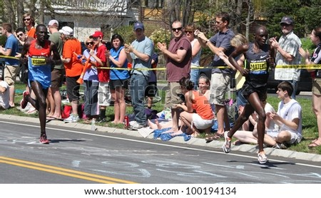 BOSTON - APRIL 16: Matebo and Kisorio (both Kenya) race up Heartbreak Hill during the Boston Marathon on on April 16, 2012 in Boston. Korir, Wesley (Kenya) finished first with a time of 2:12:40. - stock photo