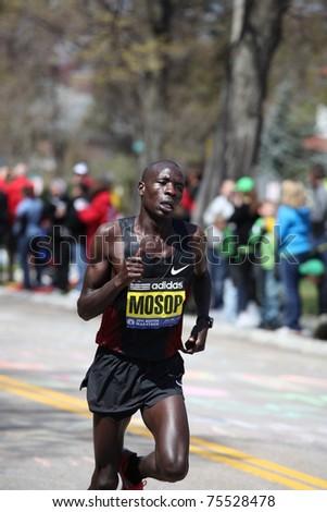 BOSTON - APRIL 18 : Moses Mosop races up Heartbreak Hill during the Boston Marathon April 18, 2011 in Boston. He ran the fastest marathon 2:03:06 debut ever in the Boston Marathon - stock photo