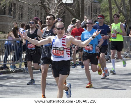 BOSTON - APRIL 21: Runners encourage the fans to cheer as 36000  runners participated in the Boston Marathon on April 21, 2014 in Boston. Meb Keflezighi (USA) finished first with a time of 2:08:37. - stock photo