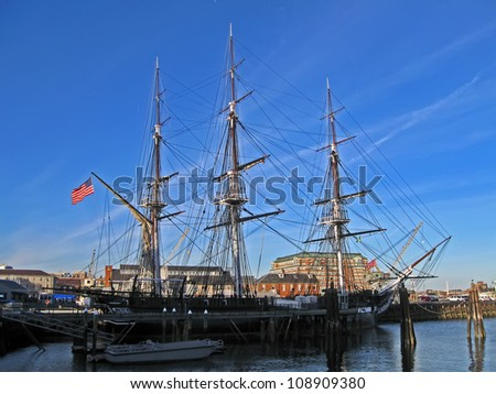 BOSTON - APRIL 21: The USS Constitution is the world's oldest commissioned naval vessel afloat anchoring in Boston (Massachusetts) on April 21, 2012 in Boston, USA. - stock photo
