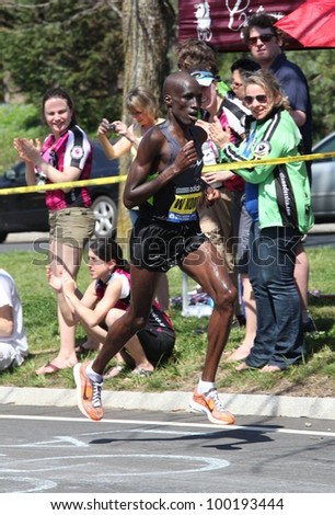 BOSTON - APRIL 16: Wesley Korir (Kenya)races up Heartbreak Hill during the Boston Marathon on a hot 87 degree day on April 16, 2012 in Boston. He finished first with a time of 2:12:40. - stock photo