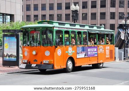 BOSTON - AUG 13: Boston Old Town Trolley Tours in downtown on August 13, 2013 in Boston, Massachusetts, USA.  - stock photo