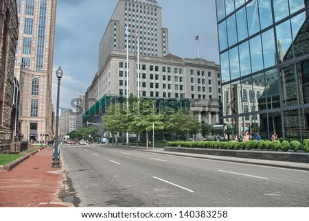 BOSTON - AUG 15: Tourists walk along city streets, August 15, 2009 in Boston. More than 10 million people visit the city every year. - stock photo