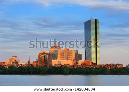 Boston Charles River with urban city skyline at sunset - stock photo