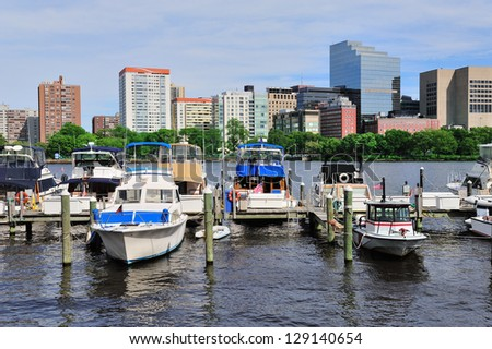 Boston Charles River with urban city skyline Hancock building and boats with blue sky. - stock photo