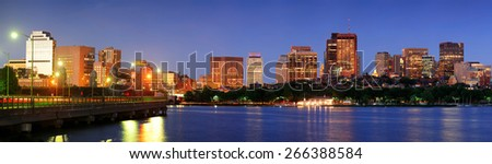 Boston city Charles River with highway bridge at dusk with urban skyline and skyscrapers. - stock photo