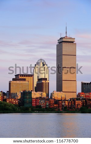 Boston city skyline with Prudential Tower and urban skyscrapers over Charles River. - stock photo