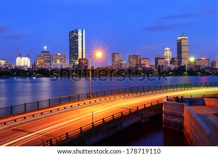 Boston cityscape from Cambridge. Charles River, Memorial Drive and people hanging out at night - stock photo