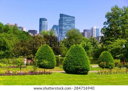 Boston Common park gardens and skyline in Massachusetts USA - stock photo