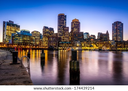 Boston Harbor and Financial District at sunset in Boston, Massachusetts, USA. - stock photo