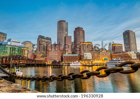 Boston Harbor and Financial District at twilight in Boston, Massachusetts. - stock photo