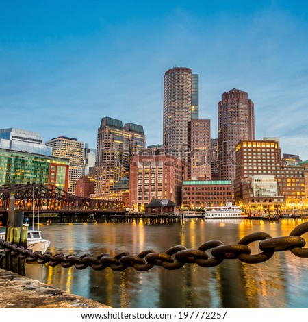 Boston Harbor and Financial District at twilight in Boston, Massachusetts.
