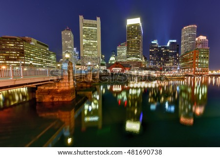 Boston Harbor in Massachusetts, USA with its mix of modern and historic architecture at night.