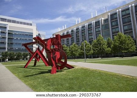 BOSTON - JUNE 06: Red Sculpture in front of Ray and Maria Stata Center on the campus MIT. Photo taken on June 06, 2014 in Cambridge, Massachusetts, USA.