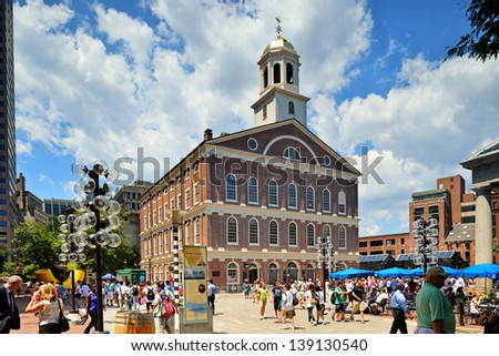 BOSTON, MA - JUNE 9: A crowd of tourists and locals at Faneuil Hall, rated number 4 in America's 25 Most Visited Tourist Sites by Forbes Traveler in 2008. As seen on June 9, 2012 in Boston, MA - USA. - stock photo
