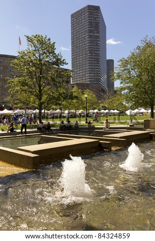 BOSTON, MA - SEPT 9: Locals and tourists enjoy the last days of summer at Copley Square in Boston Massachusetts on September 9, 2011 before the incoming winter season. - stock photo