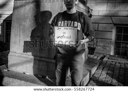 "Boston, Ma, USA - 10 11 2016, Young Harvard student hanging ""Our Harvard is not afraid"" sign, referred to Donald J. Trump's electoral campaign against immigrants."