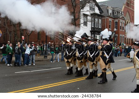 BOSTON, MASSACHUSETTS - MARCH 16: A group of riflemen commemorating the revolution of the 12 states at the Saint Patrick's Day parade held March 16, 2008 in Boston, Massachusetts. - stock photo