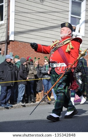 BOSTON, MASSACHUSETTS - MARCH 17: Drum major of the Quaboag Highlanders Pipes and Drums Corps from Monson, Massachusetts marches in the annual St Patrick's Day Parade through South Boston.