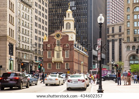 BOSTON, MASSACHUSETTS - MAY 14, 2016:  Street view of historic Old State House along Boston's Freedom Trail, with cars visible.  This landmark is the oldest surviving building in Boston.