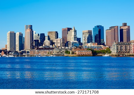 Boston Massachusetts skyline from Harbor in USA - stock photo