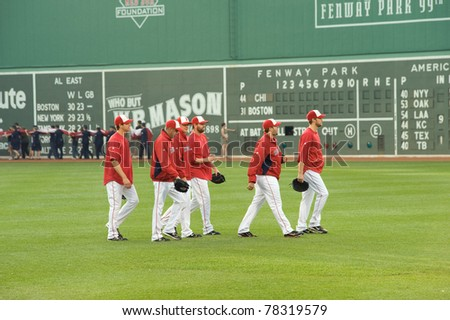 BOSTON - May 30:  Boston Red Sox relief pitchers head to the bullpen before Memorial Day game at historical Fenway Park on May 30, 2011 in Boston, Massachusetts. - stock photo