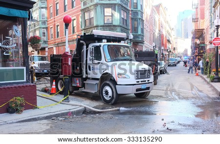 BOSTON, OCT.7: Single axle truck chassis equipped with dump body parked at a roadworks construction site in Boston, Massachusetts, United States taken on Oct. 7, 2015. - stock photo