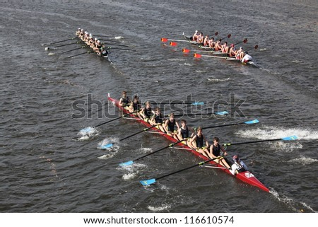 BOSTON - OCTOBER 21: Bishop Ireton HS (R) Tulsa Rowing (C) Sagamore(L) races in the Head of Charles Regatta, Marin Rowing Association won with a with a time of 12:59 on October 21, 2012 in Boston, MA. - stock photo