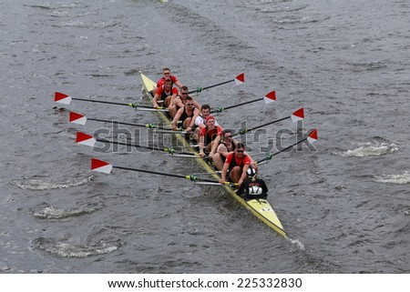 BOSTON - OCTOBER 19, 2014: Boston University races in the Head of Charles Regatta Men's Championship Eights, Craftsbury Sculling Center won with a time of 14:20 - stock photo