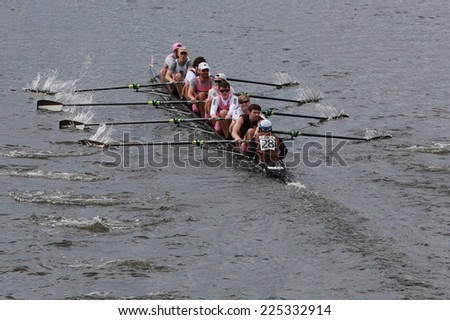BOSTON - OCTOBER 19, 2014: Brown Alumni team races in the Head of Charles Regatta Men's Championship Eights, Craftsbury Sculling Center won with a time of 14:20 - stock photo