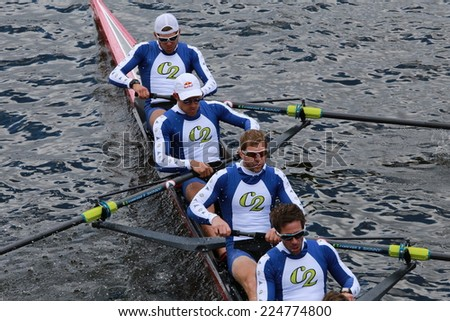 BOSTON - OCTOBER 19, 2014: Cambridge Boat Club races in the Head of Charles Regatta Men's Championship Eights, Craftsbury Sculling Center won with a time of 14:20