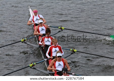 BOSTON - OCTOBER 19, 2014: Cambridge Rowing races in the Head of Charles Regatta Women's Championship Eights - stock photo