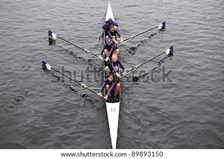 BOSTON - OCTOBER 23: College Of The Holy Cross womens Fours races in the Head of Charles Regatta. Vesper Boat Club won with a time of 18:21 on October 23, 2011 in Boston, MA. - stock photo