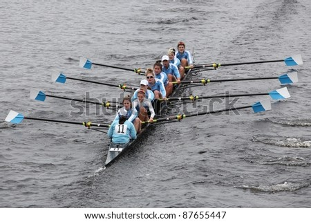BOSTON - OCTOBER 23: Columbia University women's Eights races in the Head of Charles Regatta.  Williams College won with a time of 14:17 on October 23, 2011 in Boston, MA. - stock photo