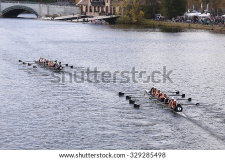 BOSTON - OCTOBER 18, 2015: Connecticut(left) and Saugatuck (right) races in the Head of Charles Regatta Women's Youth Eights - stock photo