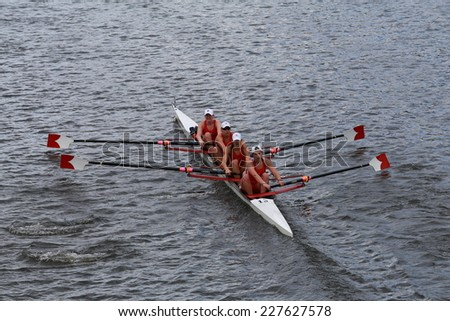 BOSTON - OCTOBER 19, 2014: Cornell University races in the Head of Charles Regatta women's Championship Fours - stock photo