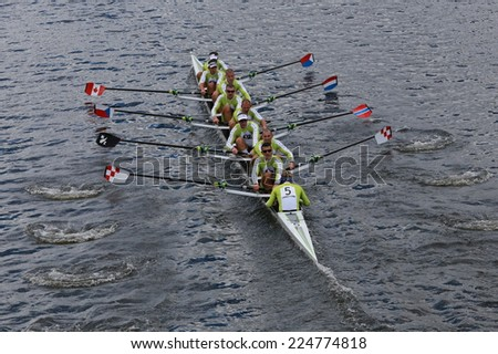 BOSTON - OCTOBER 19, 2014:  Craftsbury Sculling Center races in the Head of Charles Regatta Men's Championship Eights, they won with a time of 14:20 - stock photo