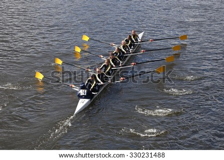 BOSTON - OCTOBER 18, 2015: Cresent Rowing races in the Head of Charles Regatta Women's Youth Eights - stock photo