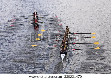 BOSTON - OCTOBER 18, 2015: CRI (left) and Merion Mercy (right) races in the Head of Charles Regatta Women's Youth Eights - stock photo